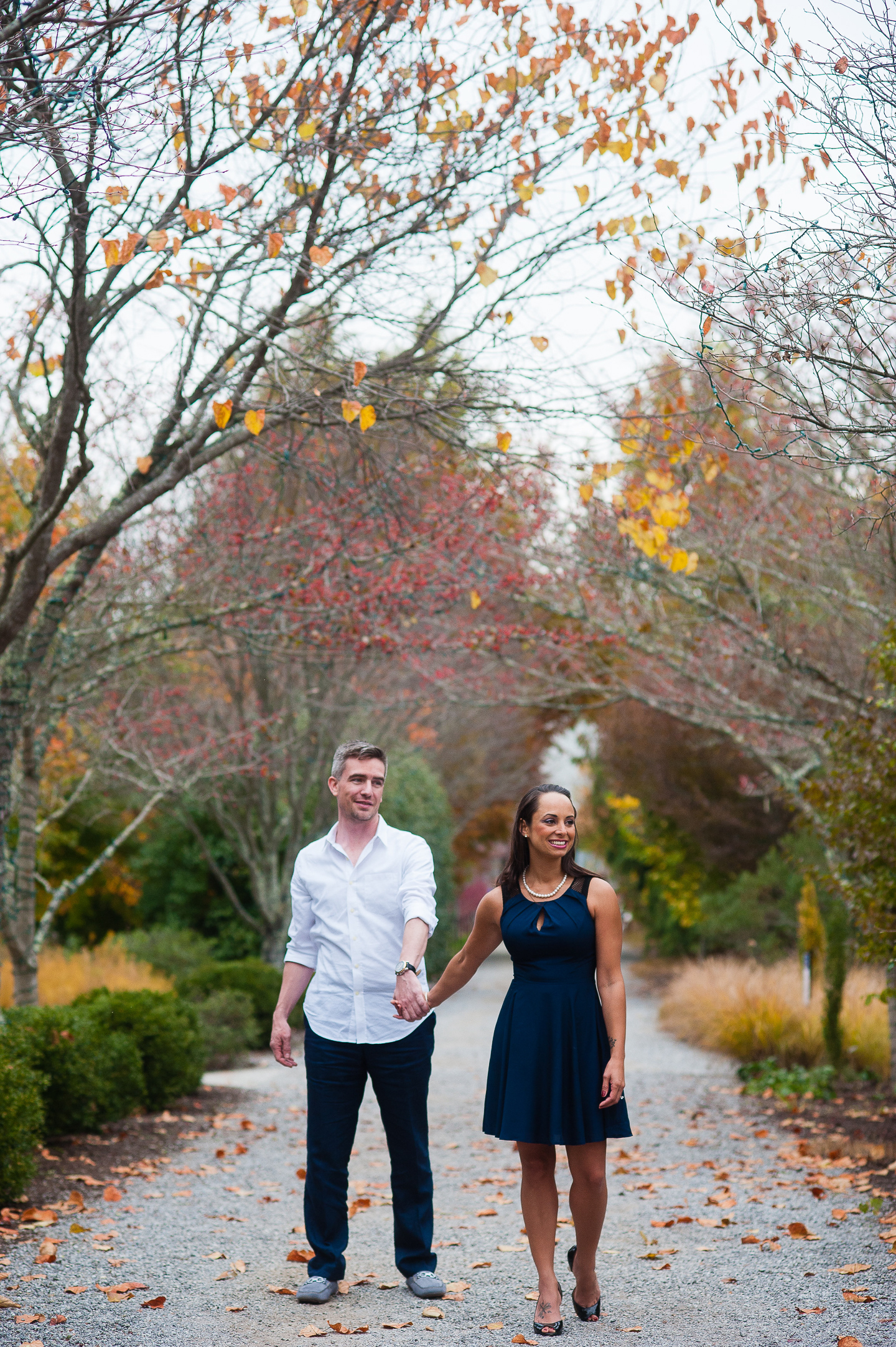 couple holding hands fall NC Arboretum engagement session