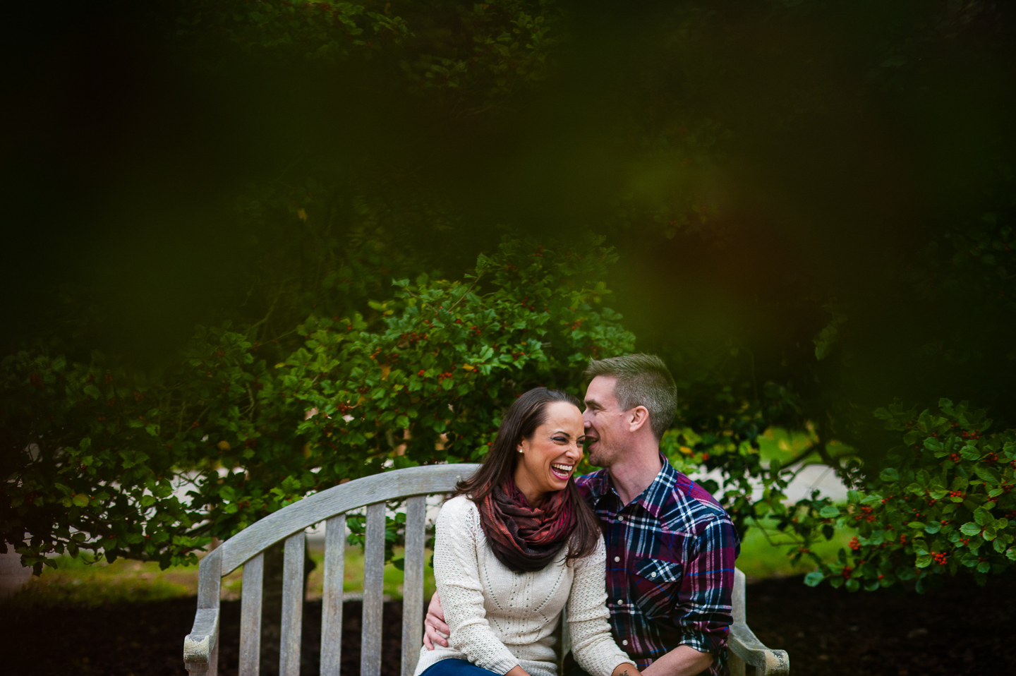 couple laughing fall engagement nc arboretum