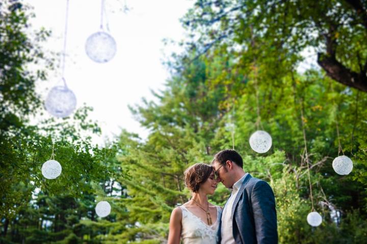 asheville summer camp wedding couple embraces under apple trees