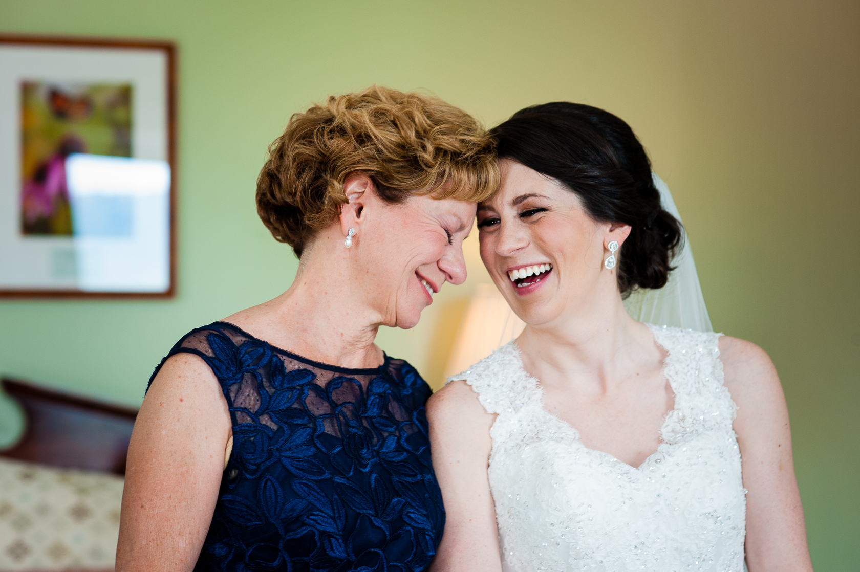 gorgeous bride and her mom laughing together