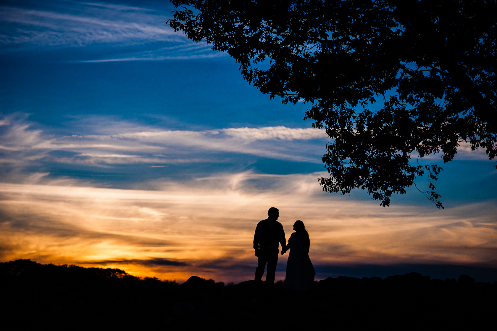 gorgeous sunset silhouette of couple