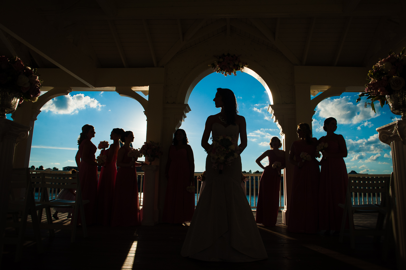 silhouette of bride and ladies Seabreeze point during disney world wedding