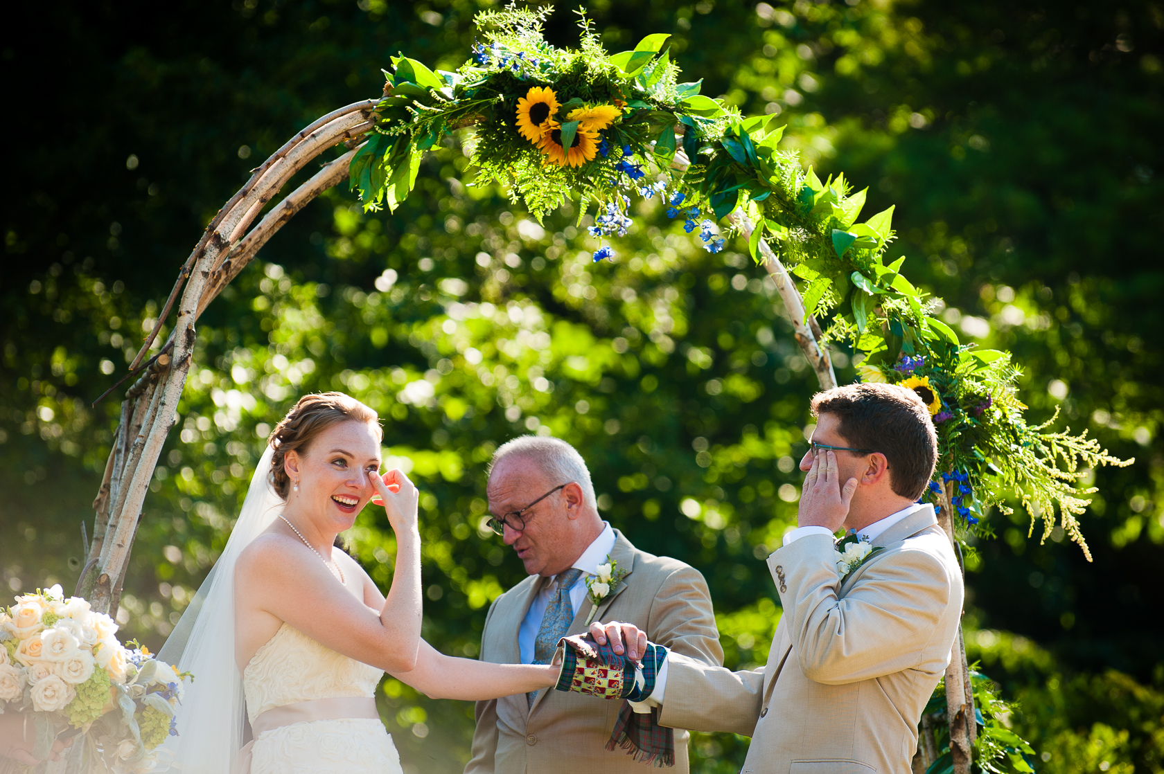 photograph of emotional moment during asheville garden wedding