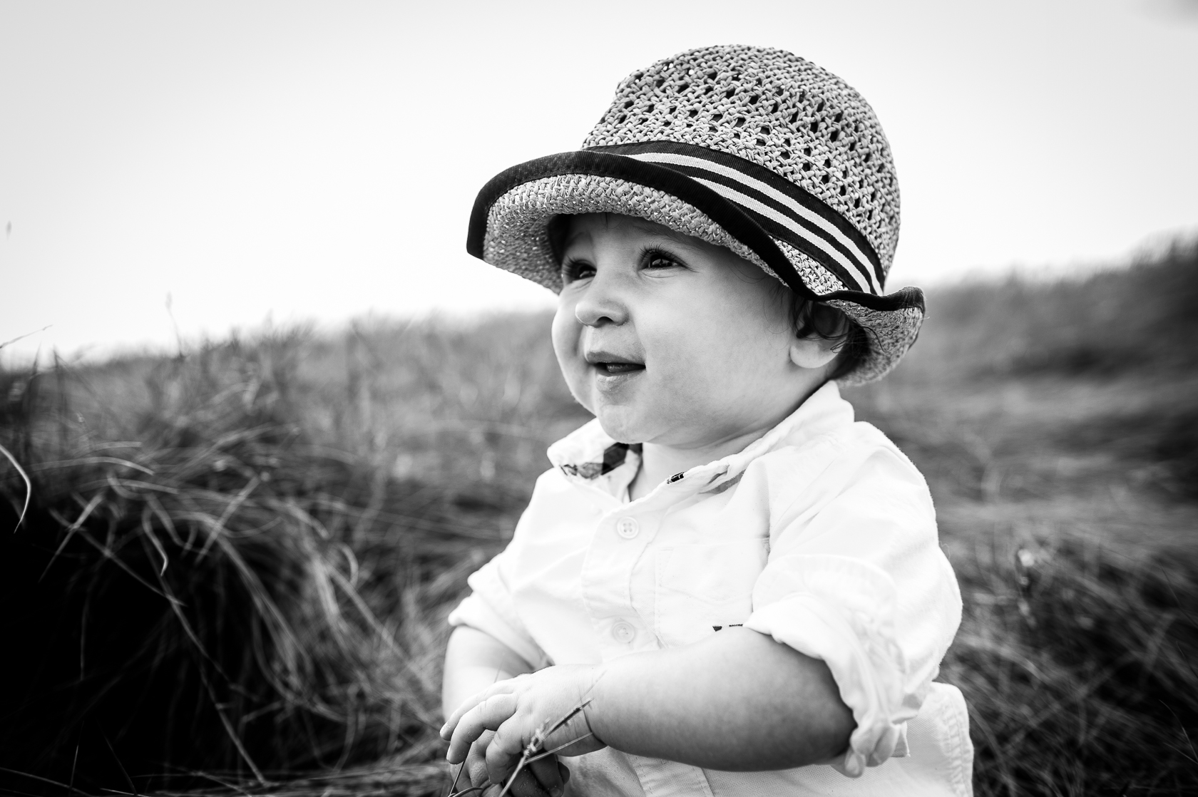 adorable little boy poses for baby portraits