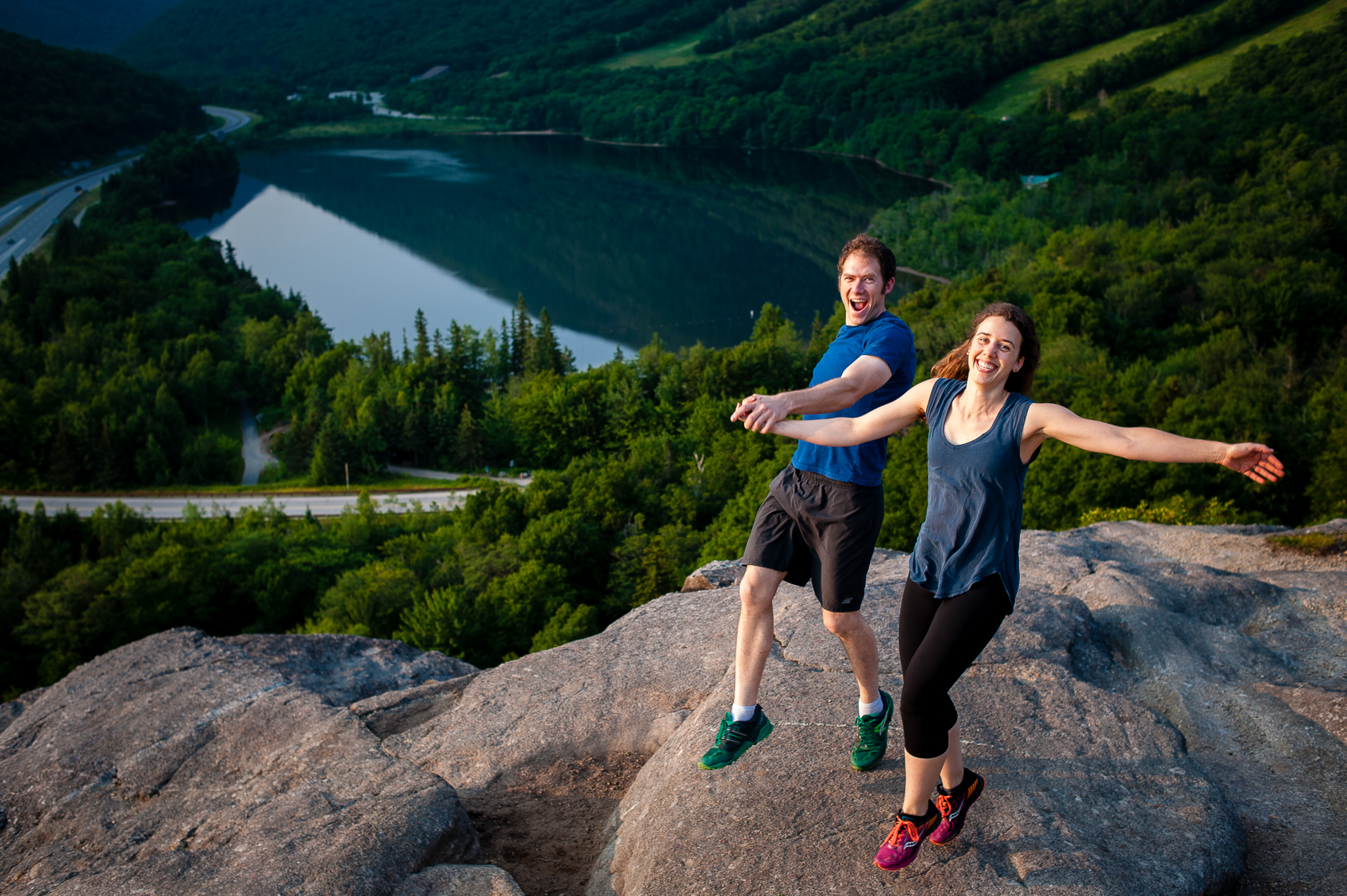 couple goofing off during their adventurous mountaintop engagement session