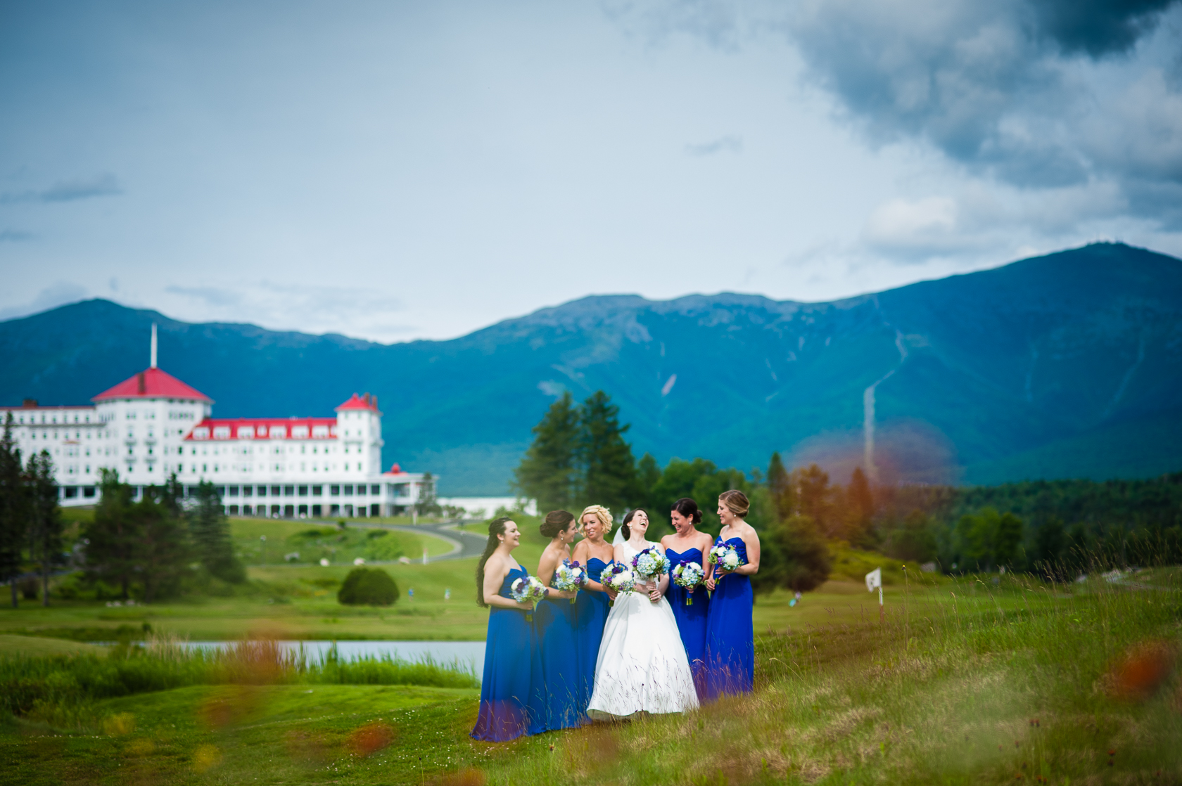 bride and her pretty ladies in field with mountains in background