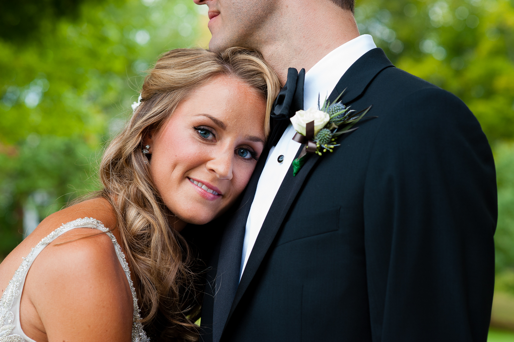pretty bride smiles during asheville summer camp wedding