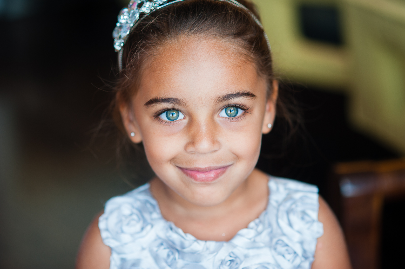 stunning flower girl with blue eyes smiling