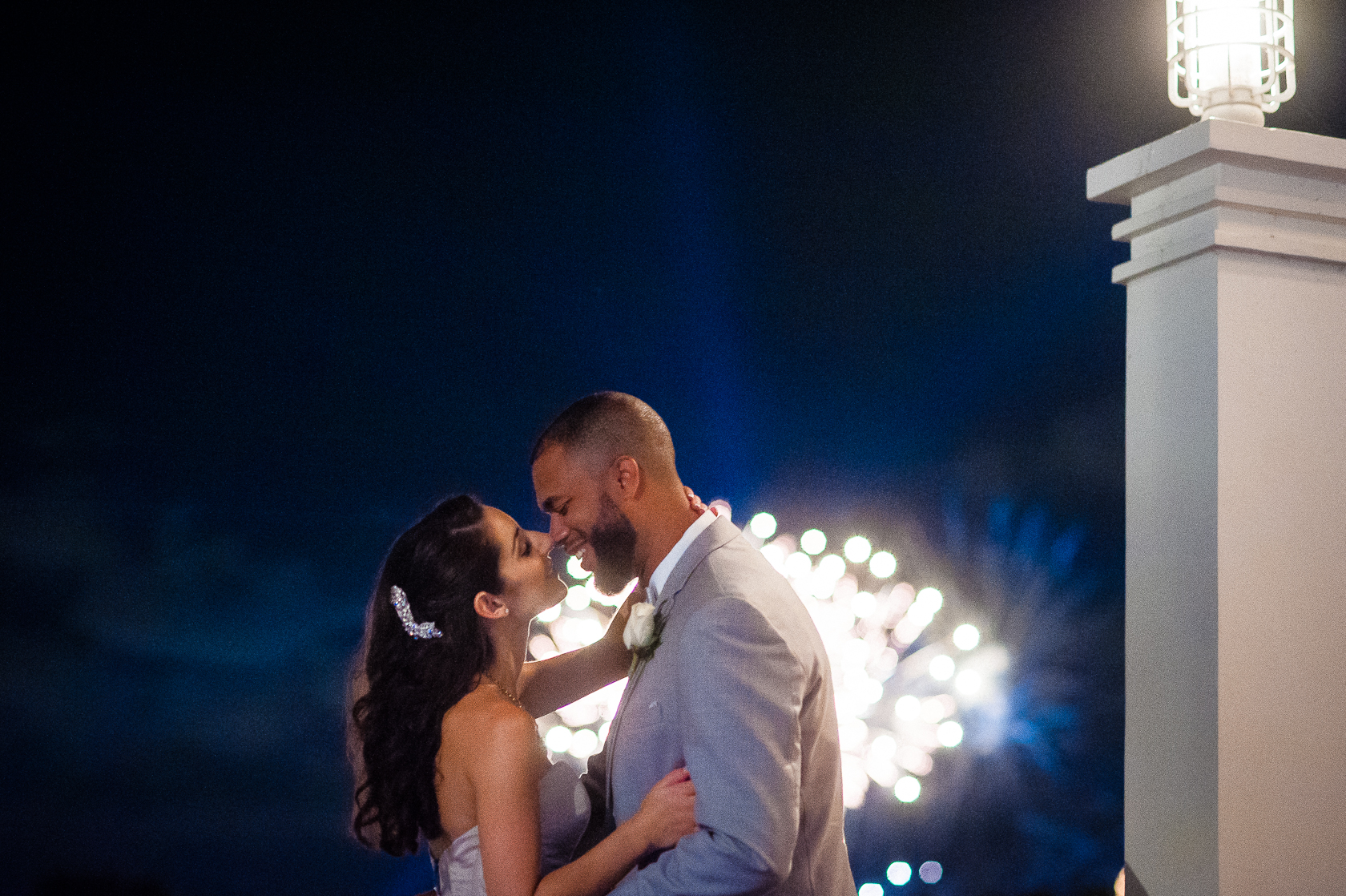 bride and groom disney world wedding with fireworks