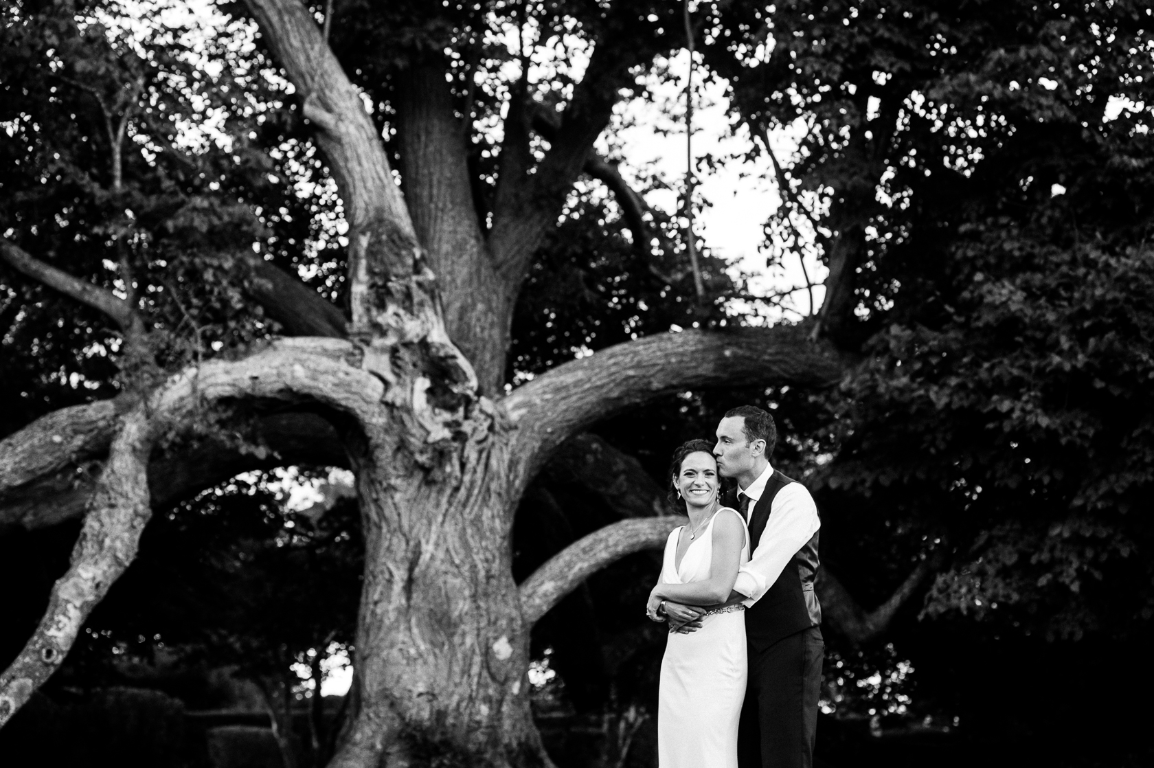 bride and groom portrait by big oak tree