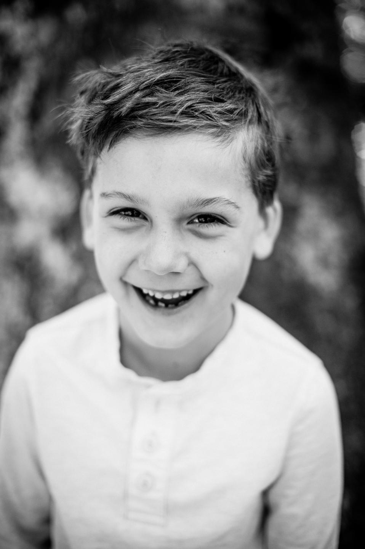 handsome boy smiles for environmental portrait