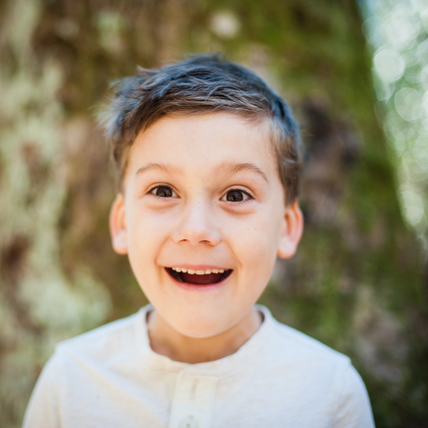adorable boy goofs off during his outdoor photo session