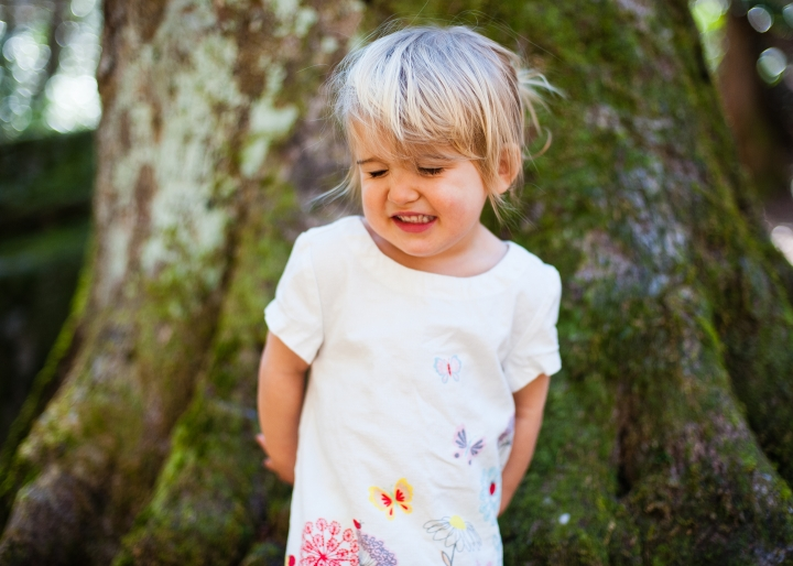 adorable toddler makes silly face during boone adventure portrait session