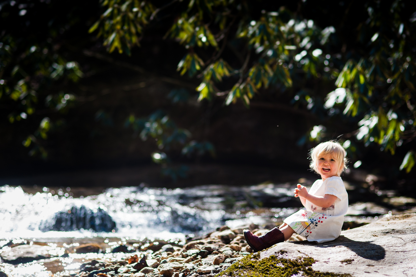 gorgeous toddler during her adventure photography session by a stream