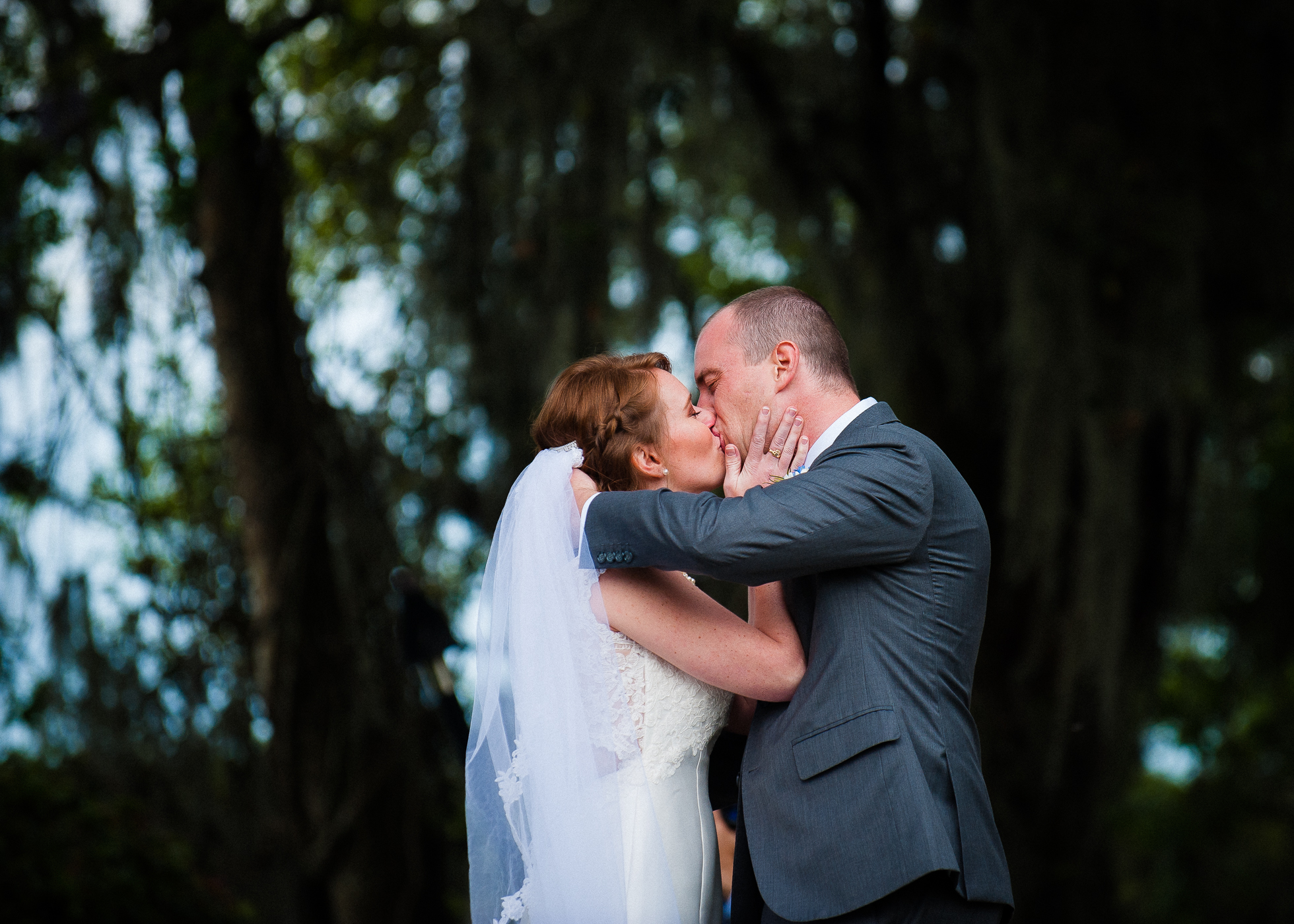 bride and groom first kiss during Magnolia Plantation wedding