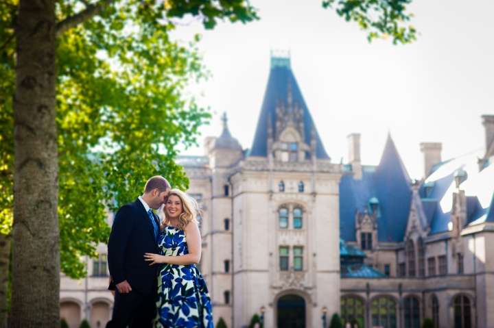 Biltmore estate engagement photo of couple in front of mansion