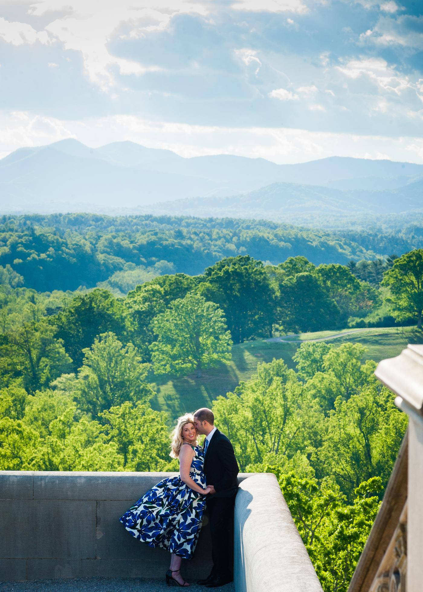 biltmore estate engagement photo on veranda with mountains behind