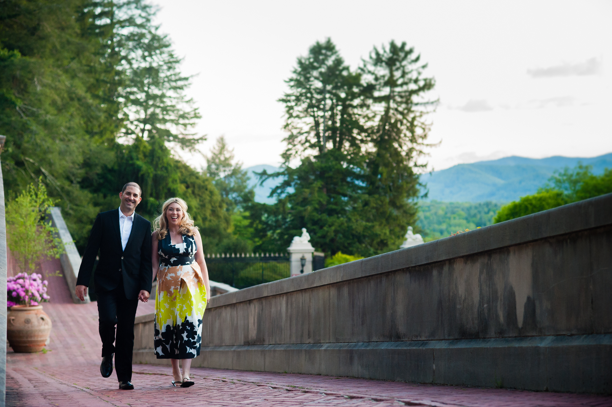engaged couple holding hands during biltmore engagement session