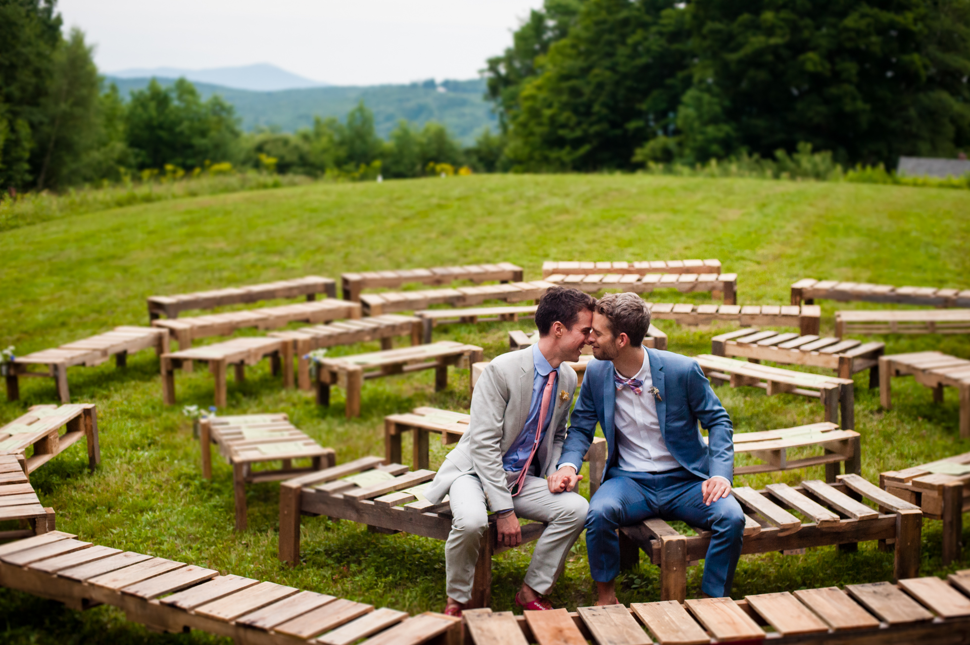 two grooms pose for wedding portraits during their mountaintop wedding