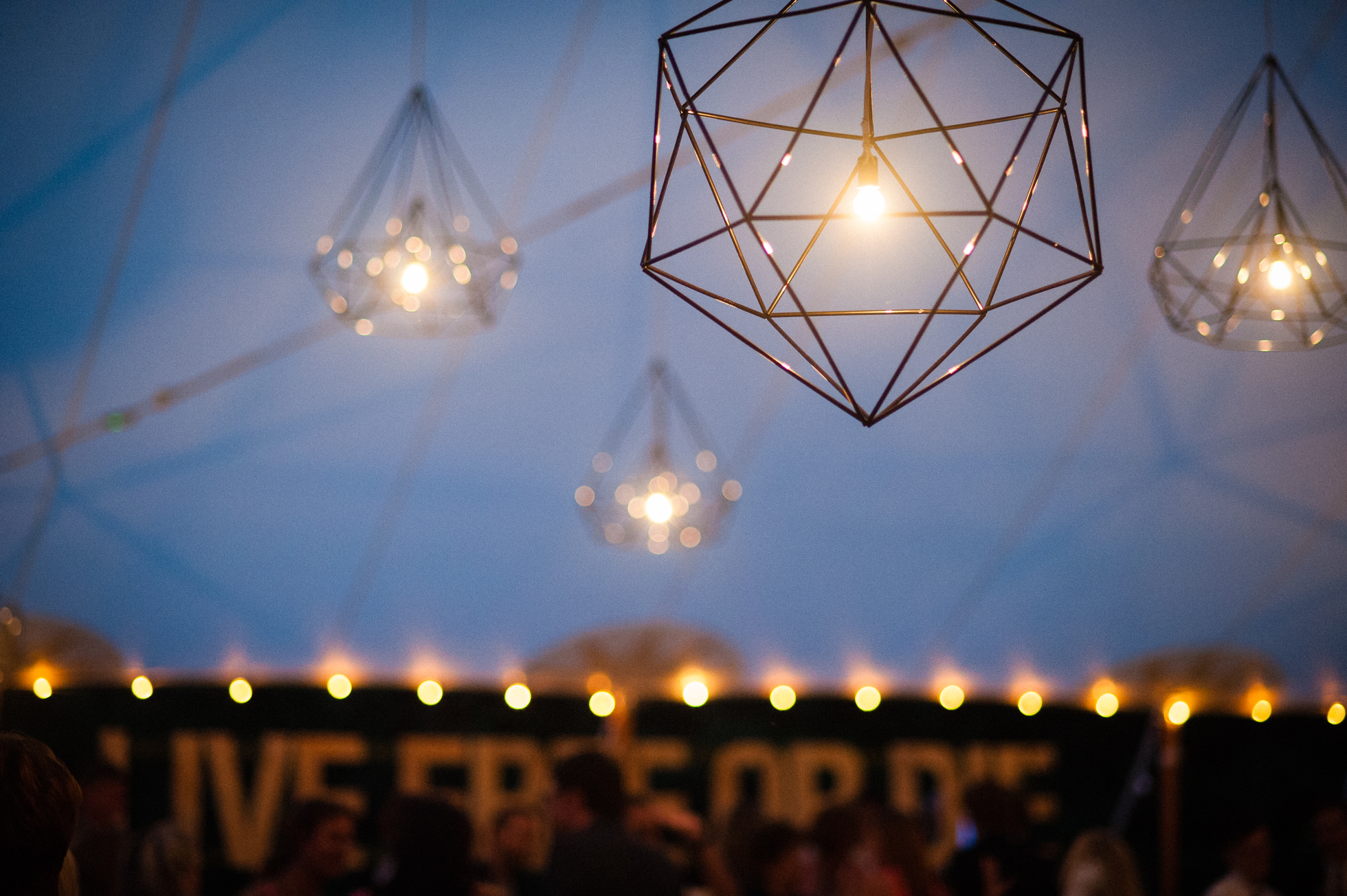 handmade gorgeous lanterns hung from sailcloth tent