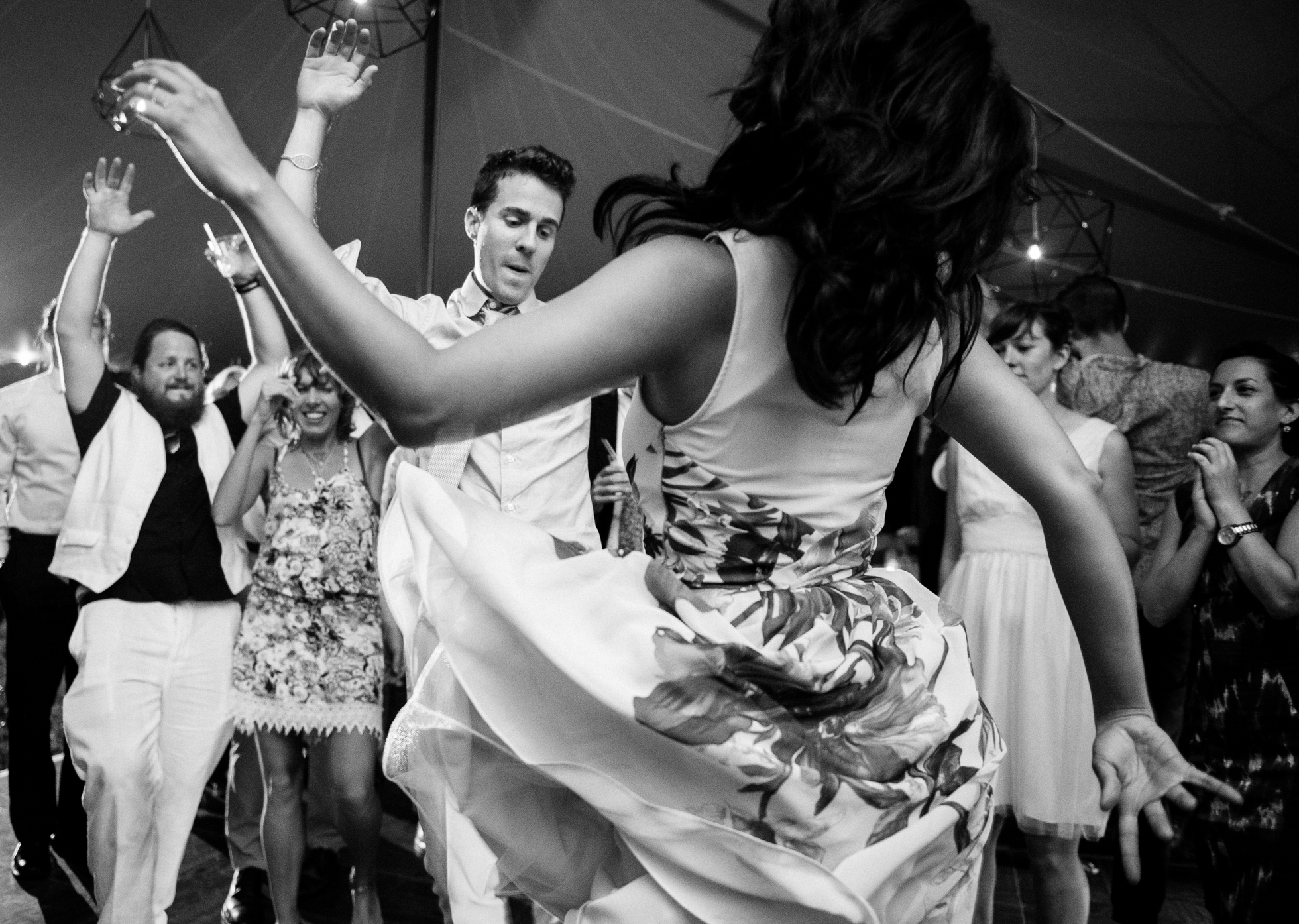 groom dancing during his tented wedding reception in asheville