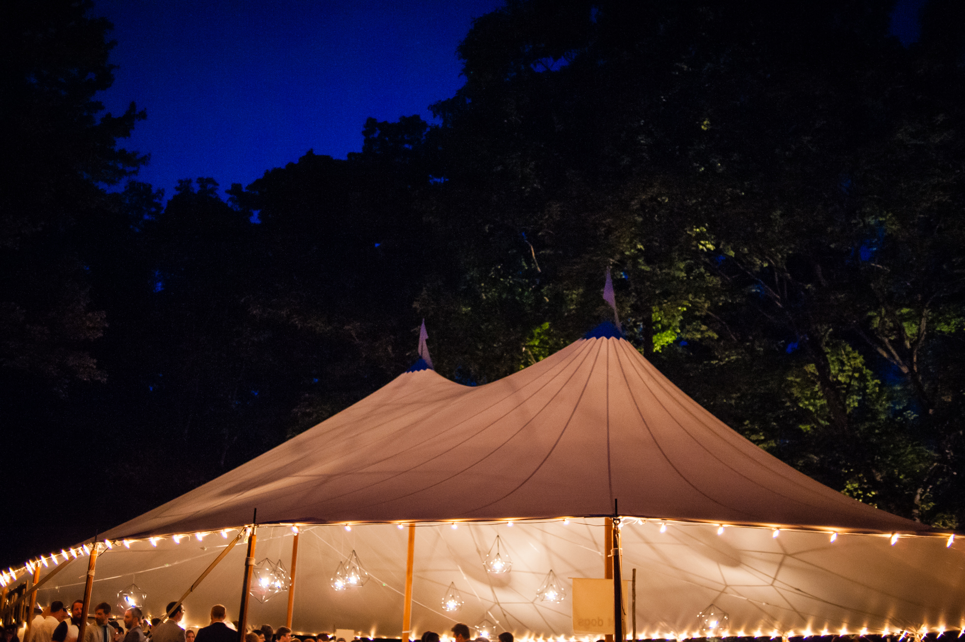 gorgeous sailcloth tent lit up at night