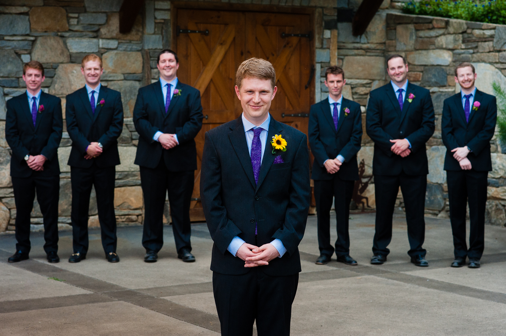 groom and groomsmen pose for portrait at asheville wedding