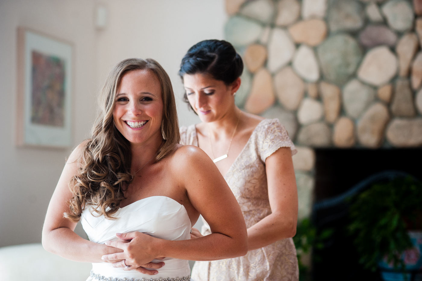 asheville wedding bride getting into dress