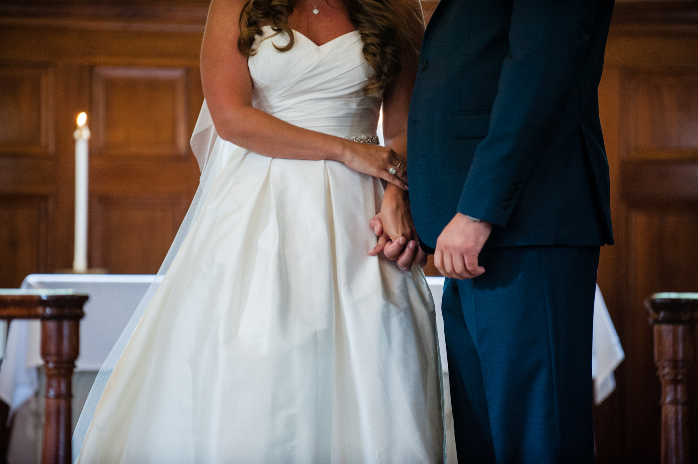 bride and groom hold hands during asheville wedding ceremony