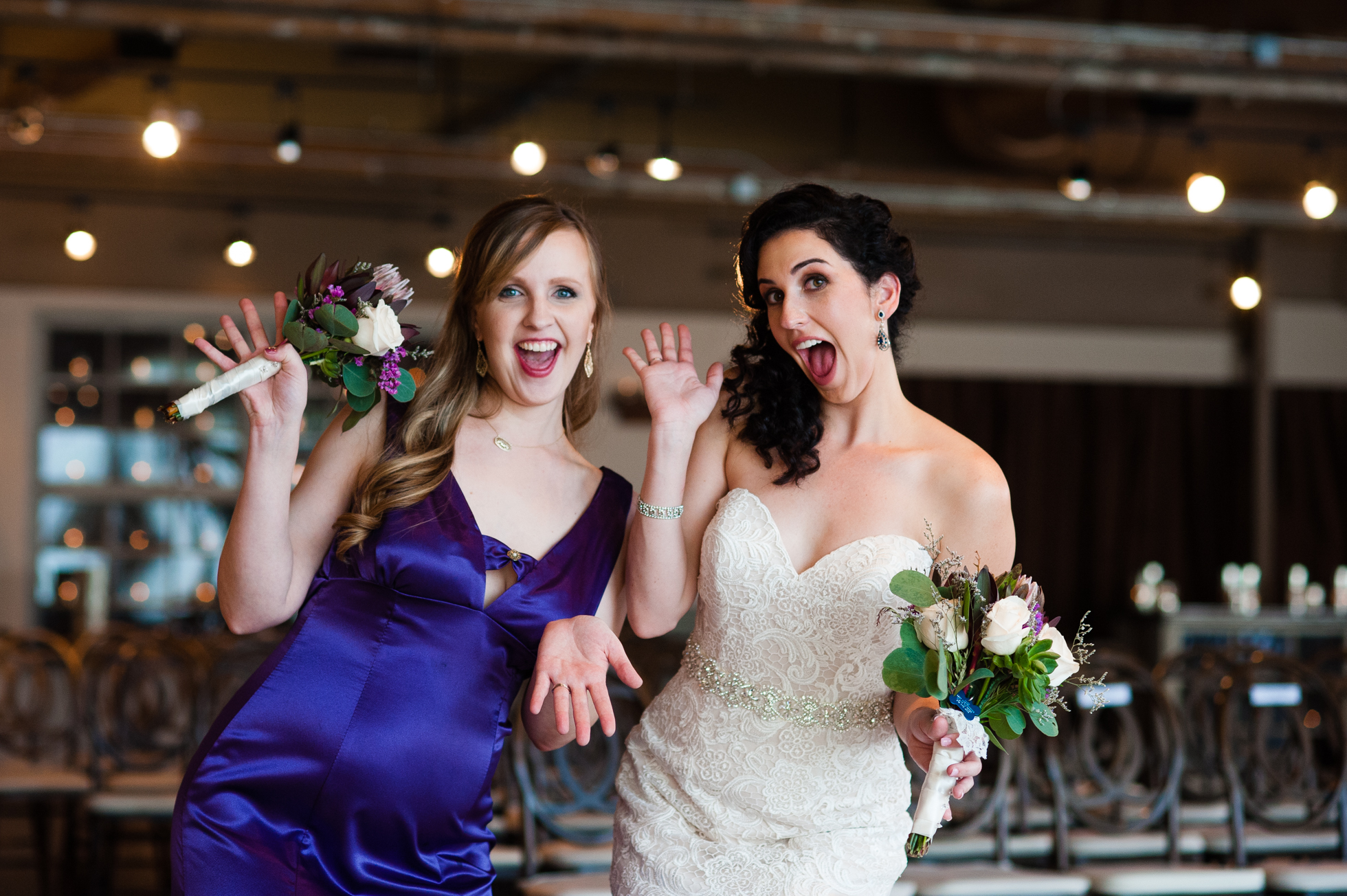 bride and bridesmaid being goofy during asheville wedding