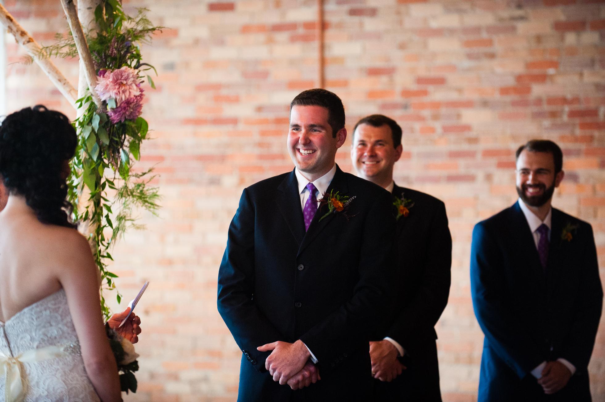 handsome groom smiling during asheville wedding ceremony