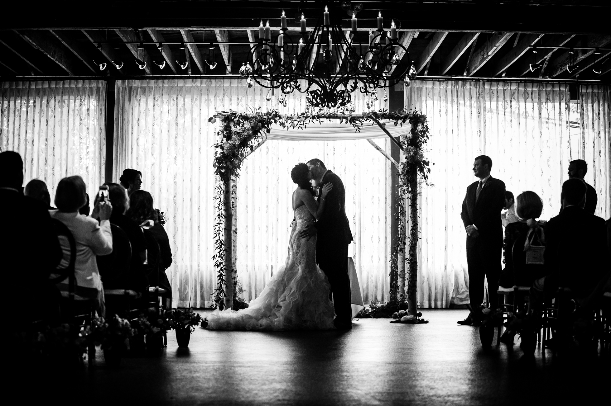first kiss during asheville wedding ceremony at the venue