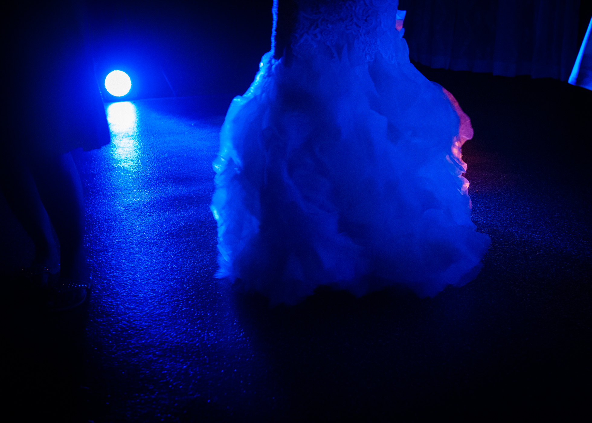 brides gown lit up on the dance floor