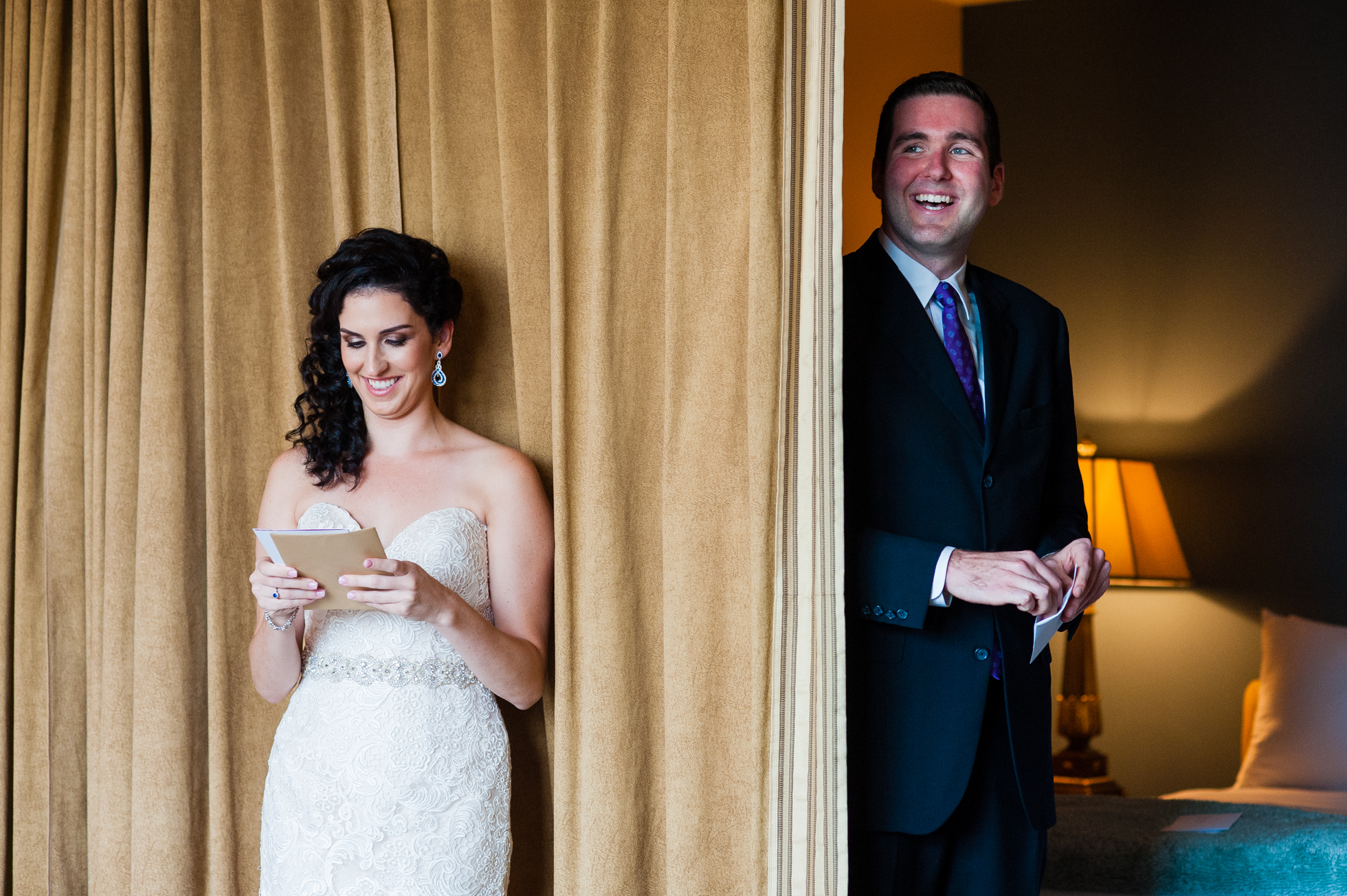 bride and groom exchanging notes during asheville first look