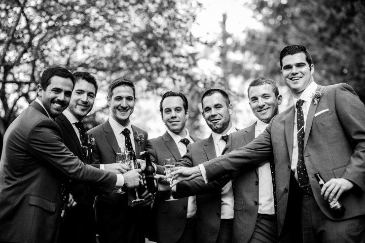 groomsmen celebrating post ceremony