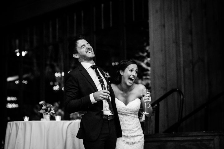 bride and groom laugh at wedding toasts