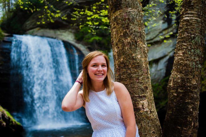 adventurous senior portraits by a waterfall