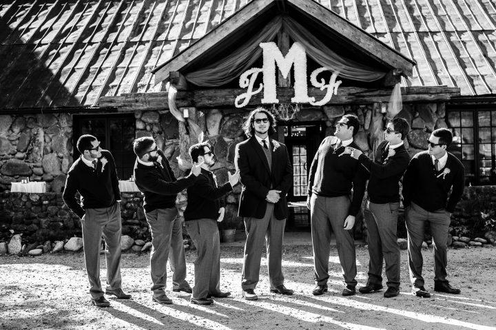 groomsmen in front of brown mountain beach resort