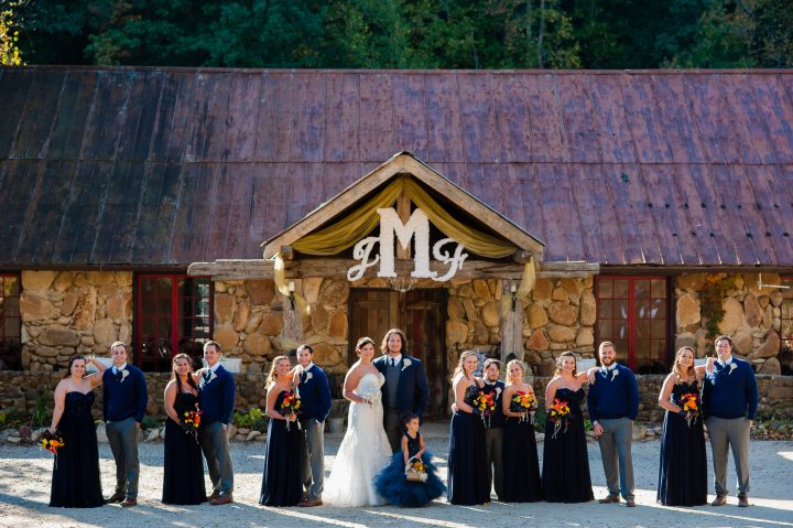 wedding party in front of brown mountain beach lodge