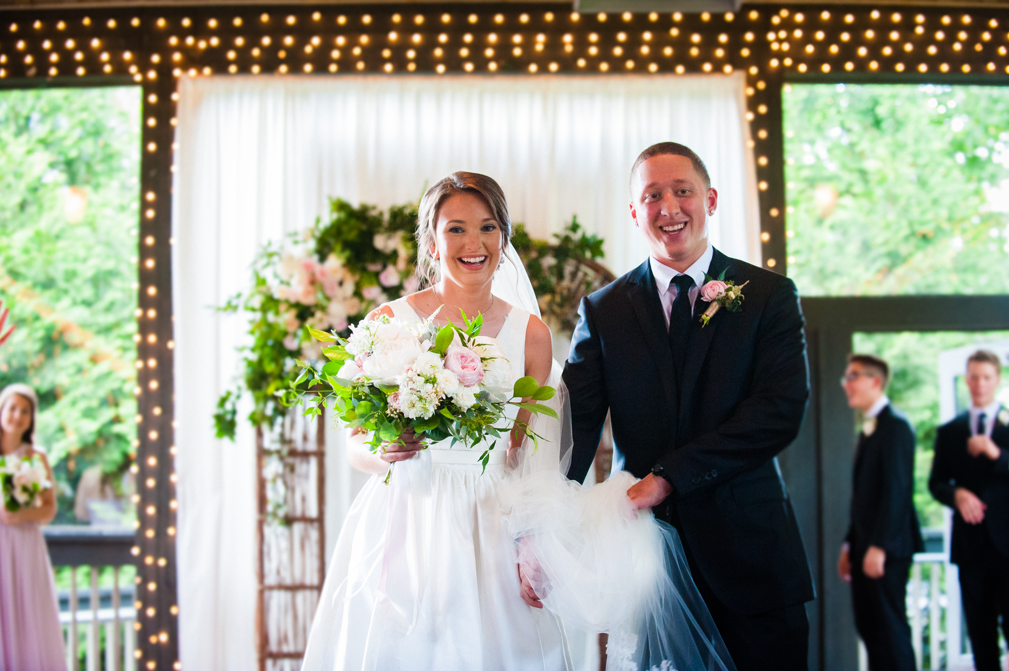 just married bride and groom walk down aisle after their wedding ceremony at Biltmore