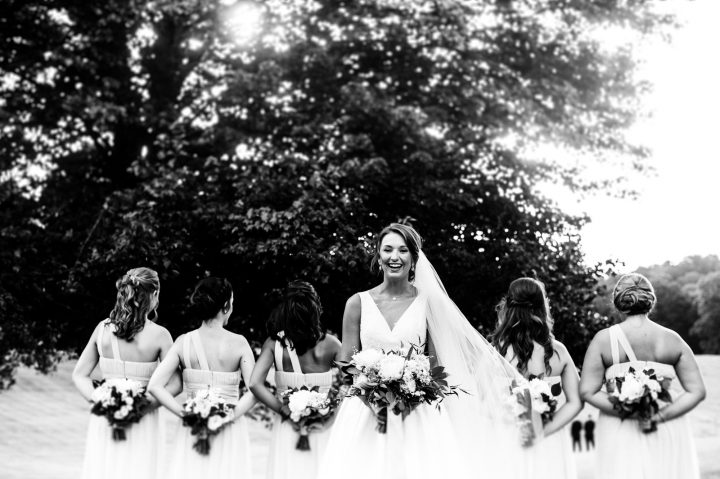 Bride and bridesmaids with beautiful bouquets by Flora