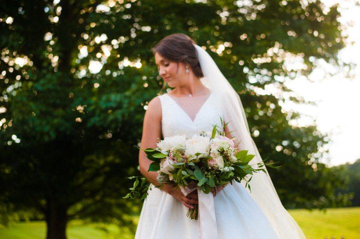 bridal portrait with gorgeous bouquet by Flora