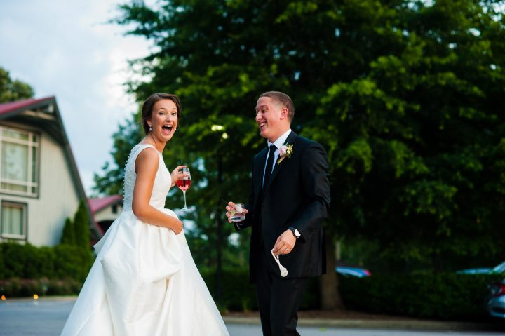 bride and groom laughing together on their wedding day