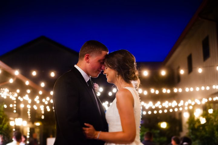 bride and groom night portrait in Lioncrest courtyard
