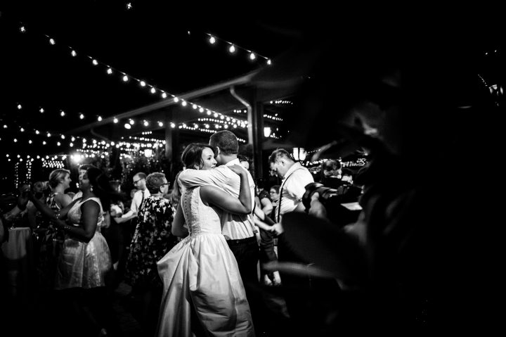 bride and groom dance in courtyard of lioncrest