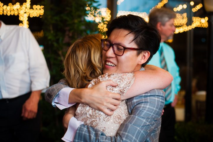 wedding guests hugging during wedding