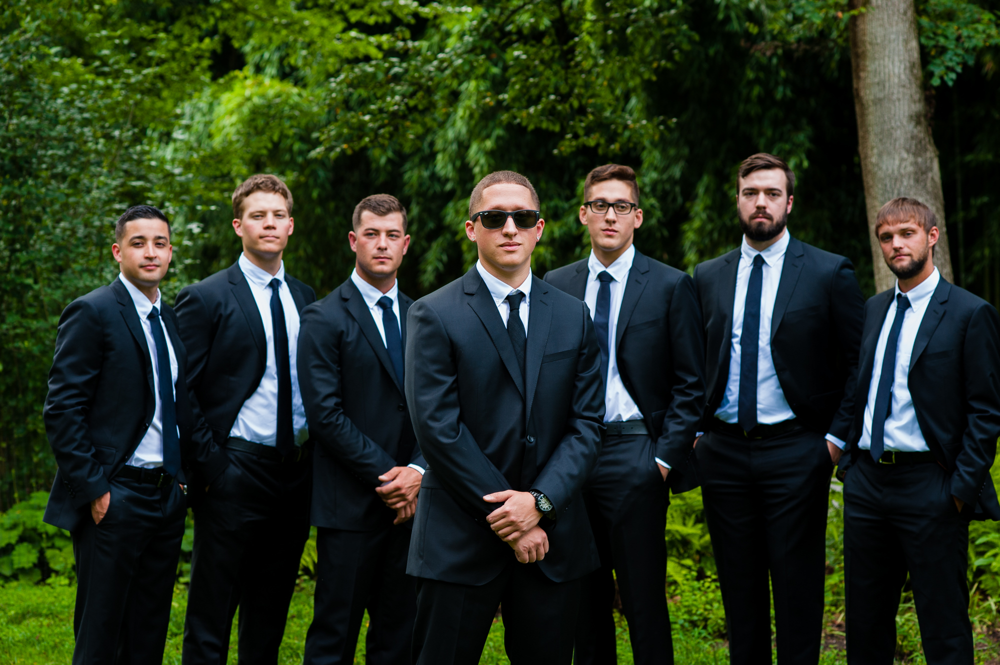 groom and groomsmen pose for portraits at the biltmore