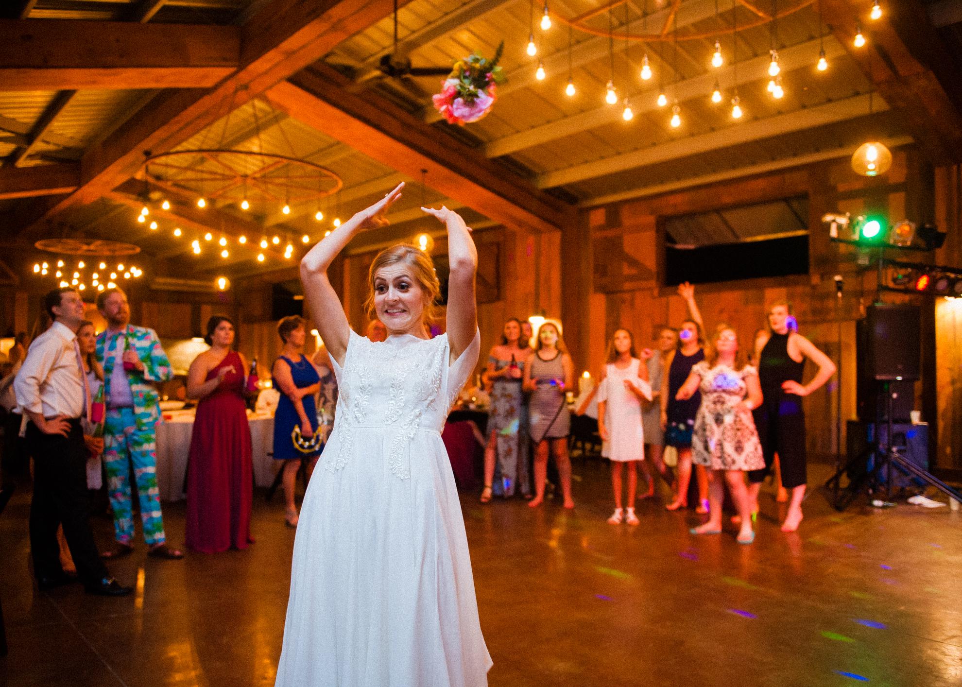 bouquet toss at vineyards at bettys creek wedding