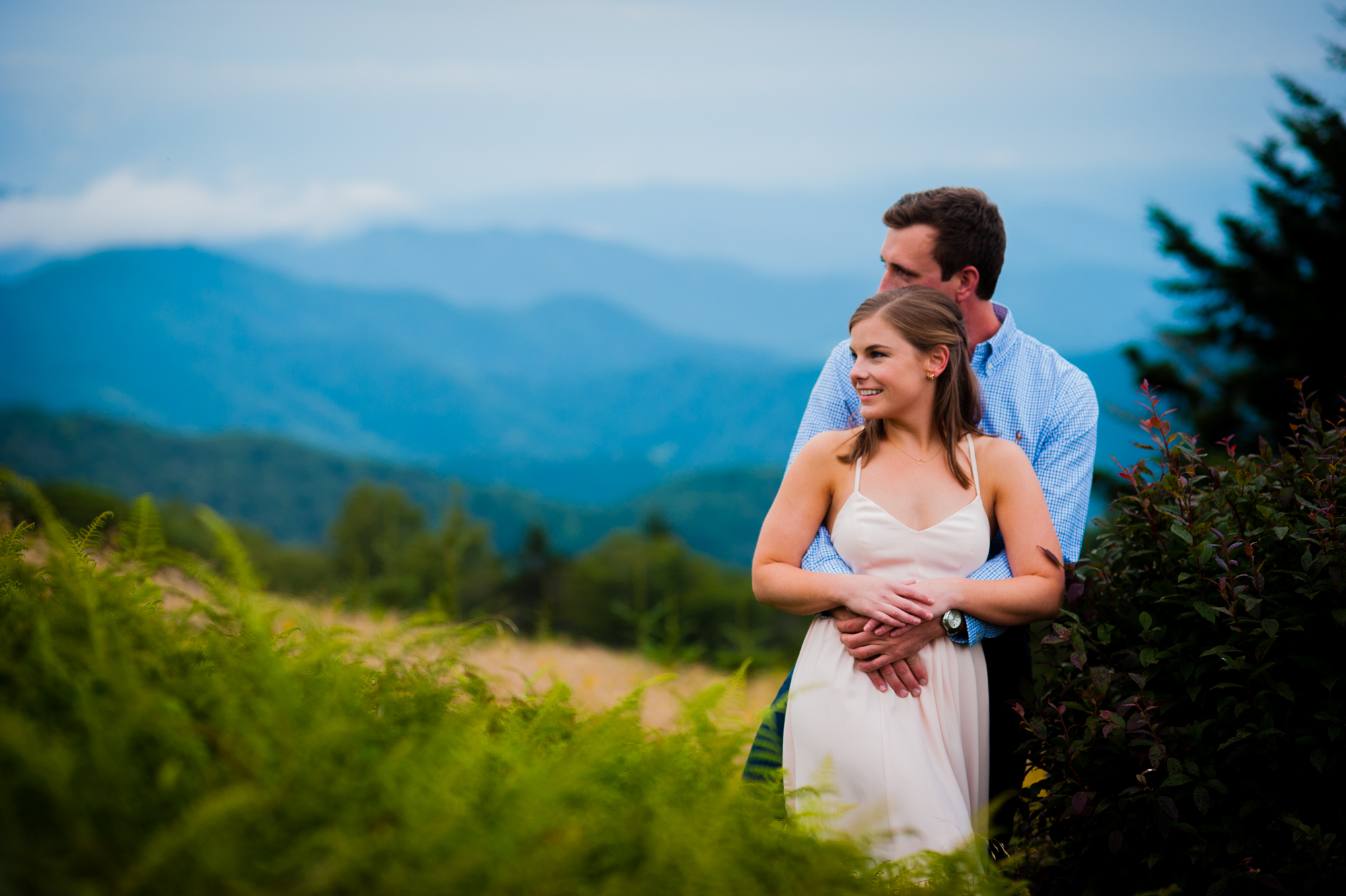 couple embrace during their roan mountain engagement session