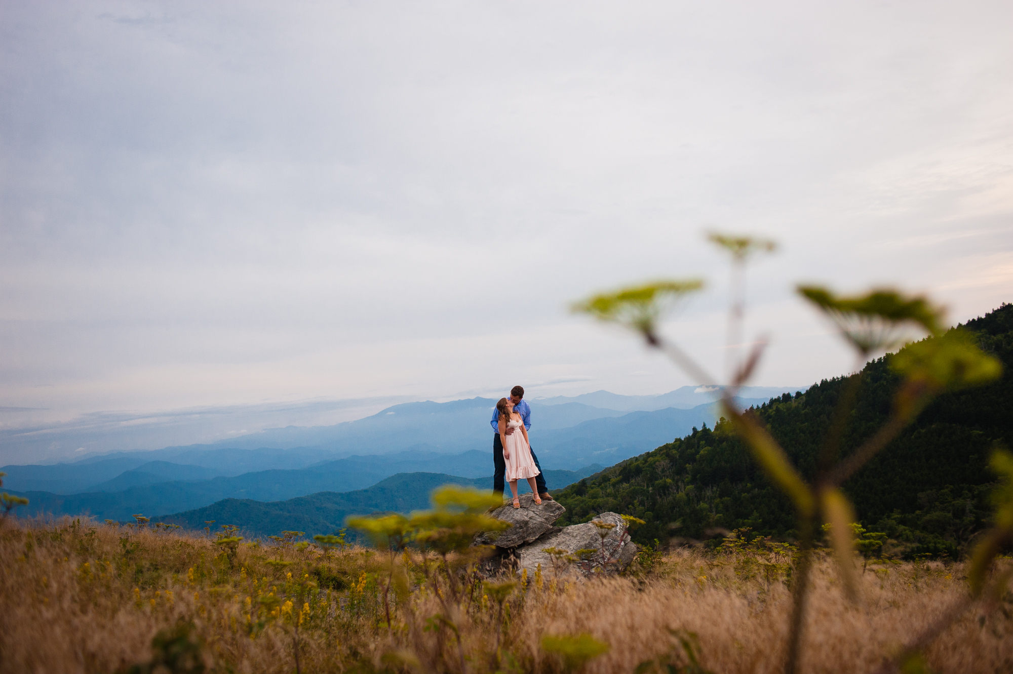 atop a rock on roan mountain during engagement session